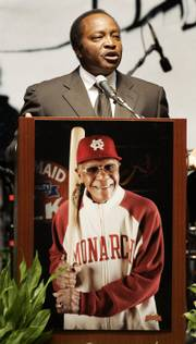 Baseball Hall of Famer Joe Morgan speaks at a memorial service for Buck O'Neil on Saturday at Municipal Auditorium in Kansas City, Mo.