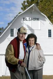 David and Margaret Shirk are longtime Lawrence-area residents known for having weddings and parties in the turn-of-the-century barn pictured behind them.