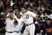 Detroit's Ivan Rodriguez, center, celebrates with teammates after the Tigers won the American League pennant. The Tigers defeated Oakland, 6-3, on Saturday in Detroit to win the series, 4-0.