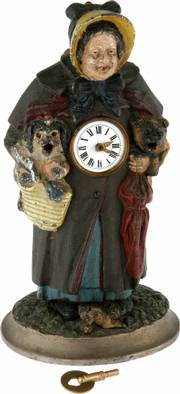 This animated figural clock was made in 1870. The tongues on the two dogs that the lady is holding move in and out of their mouths.