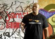 Travis Watkins, a Kansas University graduate and former Jayhawk football player, recites one of his poems during a poetry slam at Van Go Mobile Arts, 715 N.J. Watkins, now a teacher in Houston, returned Thursday to Lawrence.