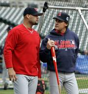 St. Louis' Albert Pujols, left, chats with skipper Tony La Russa. The Cardinals practiced Friday in Detroit.