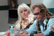 Duane ''Dog'' Chapman, right, and his wife, Beth, hold a news conference Friday in Honolulu. Attorneys for Chapman say that they've been granted an injunction by Mexican authorities while they investigate the criminal charges against their client.