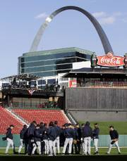 Members of the Detroit Tigers gather in the outfield during team workouts at Busch Stadium. The Tigers practiced Monday, the eve of Game 3 of the World Series.