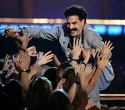 Comedian Borat Sagdiyev greets fans at the 2006 MTV Movie Awards in Culver City, Calif., in this June 3 file photo. A top Kazakh official has an invitation for British comedian Sacha Baron Cohen, whose depiction of a homophobic, misogynistic, English-mangling Kazakh journalist has outraged the Central Asian nation: Come visit.