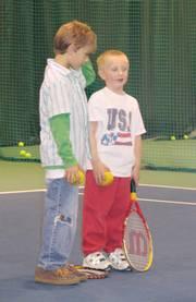 Hunter Rea, left, and Luke Hornberger talk during a tennis class at First Serve.