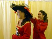 Jordyn O'Bryan, Kansas University sophomore, tries on a pirate costume at Fun and Games, 830 Mass., assisted by Betsy Mulvaney, also a KU sophomore. Across the nation, Halloween spending is up more than 50 percent compared to last year, according to the National Retail Federation.
