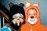 "Emma Machell and Jessica Devlin dressed up as their favorite animals, a cat and a fox, for Halloween when they were 9 and 10, respectively. Emma, now a seventh grader at West Junior High School, said it was so cold that night that they wore sweaters, sweat pants, sweatshirts and hats to keep warm. ""We looked like colorful marshmallows waddling around the neighborhood."" Emma said she remembers sorting and swapping candy with her friend."