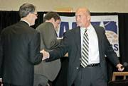 Kansas Atty. Gen. Phill Kline, left, and Democratic challenger Paul Morrison didn't have many positive things to say about each other during a debate Tuesday at Harrah's Prairie Band Casino Hotel near Mayetta.