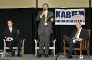 A campaign mailing sent recently to registered voters in Topeka and Lawrence contains incorrect information about the state's murder rate. The mailing claims violent crimes have skyrocketed during Atty. Gen. Phill Kline's investigation of abortion records, but the 2002 statistics were incorrect. Kline, left, and opponent Paul Morrison met Tuesday in a debate in Mayetta. At center is Washburn University political science professor Bob Beatty. Morrison's campaign manager said the Democrat and his staff didn't have prior knowledge of the mailing.