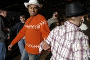 Pharmaceutical graduate students in town for a conference received a crash course in square dancing Thursday at the Circle S Ranch and Country Inn. Hagdeep Giri, from the University of Minnesota, in orange, was among those enjoying the evening.