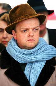 "Truman Capote (Toby Jones) spends six years investigating the murders of a Kansas farm family for his true-crime novel, ""In Cold Blood,"" in the biopic ""Infamous."""