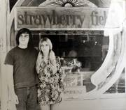 A twentysomething Kim Kern, left, embraces his then-wife Jenny in front of Strawberry Fields, 712 Mass. Kern opened the store in 1968 as a head shop that became a counterculture hangout. Through the years, Fields has had many different faces. It has been a fine art gallery since 2000, but Kern is closing the store to spend more time painting.