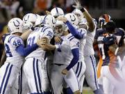 Indianapolis Colts kicker adam vinatieri (4) is mobbed by teammates Justin Snow (48), Bryan Fletcher (81) and Hunter Smith (17) after Vinatieri kicked the winning field goal against Denver. The Colts won a thriller over the Broncos, 34-31, Sunday in  Denver, with Vinatieri's kick sealing the deal with just two seconds remaining.