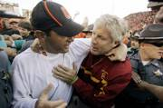 Southern California coach Pete Carroll, right, congratulates Oregon State coach Mike Riley after Oregon State beat USC, 33-31, on Saturday in Corvallis, Ore. Southern Cal's loss shook up the BCS outlook.