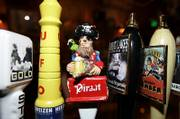 Artsy tap handles are displayed at Surly Girl Saloon in Columbus, Ohio.