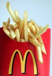 McDonald's french fries have been cooked in partially hydrogenated vegetable oil since the company abandoned beef tallow in 1990. Today, New York City's Board of Health will hold its first public hearing on a plan to make New York the first U.S. city to ban restaurants from serving food containing artificial trans fats.