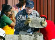Former U.S. President Jimmy Carter builds a house as part of the 23rd Jimmy Carter project Monday in Patan Village, southeast of Bombay, India. The 23rd Jimmy Carter Work Project will build 100 homes in a week around the world.