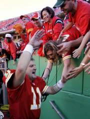 Huard celebrates with fans after leading the Chiefs to a 35-28 victory against Seattle on Sunday. The victory was Kansas City's second straight against a playoff contender. The Chiefs stand at 4-3.