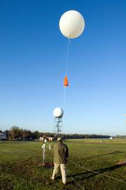 Weather balloons, such as this one about to be released by Calvin Meadows in Sterling, Va., are deployed in 92 locations across the United States. This operation may become obsolete if a network of high-tech sensors installed on some U.S. passenger planes succeeds.