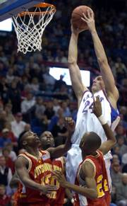 Kansas University&#39;s Sasha Kaun dunks over a trio of Pittsburg State players. KU&#39;s junior center won&#39;t be dunking on anyone for at least the next three weeks as he recovers from a partial tear of the patellar tendon in his right knee.