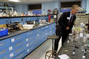 State Sen. John Vratil inspects a lab in Malott Hall during a tour of the Kansas University campus in Lawrence. The Kansas Board of Regents hosted a tour of the university Thursday for legislators and candidates to bring attention to deferred maintenance issues.