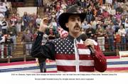 "Borat (Sacha Baron Cohen) mangles the national anthem at a Virginia rodeo in ""Borat."""