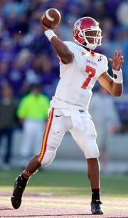 Iowa State quarterback Bret Meyer throws to a receiver during the second half of last week's loss to Kansas State. Meyer is one of the few healthy ISU skill-position players heading into today's game with Kansas.