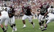 Texas A&M's Jorvorskie Lane (11) runs up the middle during the third quarter of the Aggies' game against Missouri in this file photo.