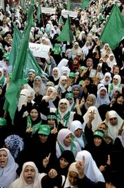 Palestinian women supporters of Hamas chant anti-Israel slogans and wave the green Islamic flag Friday during a rally supporting the Hamas government in Gaza City. Two Palestinian women were killed by Israeli army fire when hundreds of women streamed to serve as human shields for militants holed up inside a Gaza mosque besieged by Israeli troops.