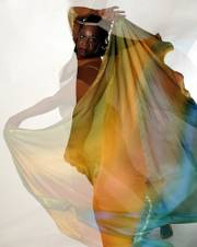 Alberta Wright, known as Masani Azura when dancing and working as an instructor, dances with a veil. Wright teaches dance as a means of expressing spirituality, meditation and faith. (A multiple exposure in the camera was use to capture this image.)