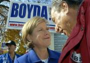 Democrat Nancy Boyda speaks with Tom Cadue, a member of the Kickapoo tribe who lives in Kansas City, Kan. Boyda, who is challenging Rep. Jim Ryun in the 2nd Congressional District, had a rally Sunday afternoon outside the Kansas Capitol.