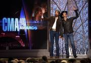 Hosts Ronnie Dunn, left, and Kix Brooks did more than lead the show at the 40th Annual CMA Awards: They won several awards, including single and song of the year. The show was Monday in Nashville, Tenn.