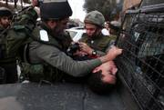 Israeli Border Police officers detain a Palestinian Monday at a temporary checkpoint in the West Bank town of Hebron. The latest round of talks involving Palestinian leaders moved ahead despite an Israeli offensive in northern Gaza border, aimed at halting Palestinian rocket fire on Israeli communities near the coastal strip.