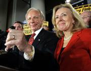 Sen. Joe Lieberman, D-Conn., and his wife, Hadassah, celebrate his victory in Hartford, Conn. Lieberman was re-elected Tuesday as an independent.