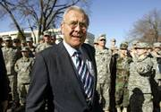 Defense secretary Donald Rumsfeld greets Army ROTC soldiers at Kansas State University in Manhattan. Rumsfeld, who announced his resignation Wednesday, visited Manhattan on Thursday to deliver a Landon Lecture and attend a dedication ceremony for the renaming of a campus building in honor of retired Army Gen. Richard Myers.