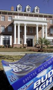 "A discarded beer box lies in the front lawn of the Chi Psi Fraternity house Friday, Nov. 10, 2006, at the University of South Carolina in Columbia, S.C. A lawsuit was filed Thursday on behalf of two fraternity brothers who claim they were duped into appearing in the spoof documentary ""Borat: Cultural Learnings of America for Make Benefit Glorious Nation of Kazakhstan,"" in which they made racist and sexist comments on camera."