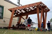 Kansas University architecture students lounge under a shade structure they built during the last school year. It is one of the early projects that KU students completed to assist New Orleans' Seventh Ward.