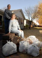 Dale and Wanda Kring are leaving their central Lawrence home of 42 years because of problems with neighboring rental properties and trash. The Krings, pictured at their home, displayed some of the trash they collected last week while walking in their neighborhood.