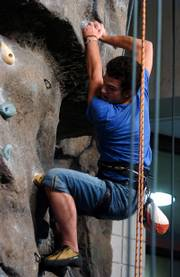 Kansas University Rock Climbing Club president Taras Zelenchuk scales the wall in the Rec Center.