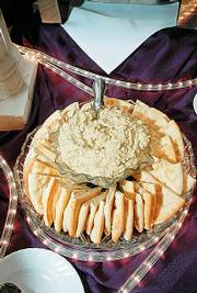 Hummus and pita wedges offer a simple recipe for easy entertainment over the holidays. These appetizers were prepared for a December 2005 party by Maceli's, a catering business at 1031 N.H.