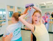 "CLARE BROWNING, 9, left, and Katelyn Rademacher, 10, rehearse for ""The Snow Queen."""