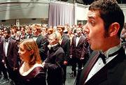 KANSAS UNIVERSITY SYMPHONIC CHOIR member Ryan Kusmin, above right, warms up before the start of the 2005 KU Vespers. This year's performance will be Dec. 3 at the Lied Center.