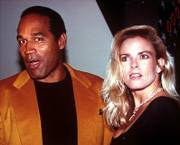 "O.J. Simpson and his wife, Nicole Brown Simpson, celebrate the opening of the Harley-Davidson Cafe in this Oct. 19, 1993, file photo. O.J. Simpson has a book coming out titled ""If I Did It,"" describing how he would have killed Nicole Brown Simpson and her friend Ronald Goldman."