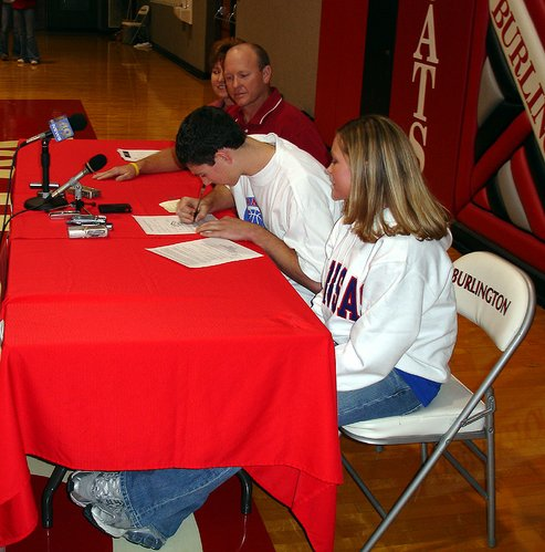 Tyrel Reed, a 6-foot-3 guard from Burlington High, signs his national letter of intent with Kansas University. Reed officially joined the Jayhawks at a signing ceremony on Nov. 15, 2006, at his high school.