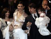 Katie Holmes and Tom Cruise, holding their daughter, Suri, became engaged in June 2005 and are expected to wed in Italy today.