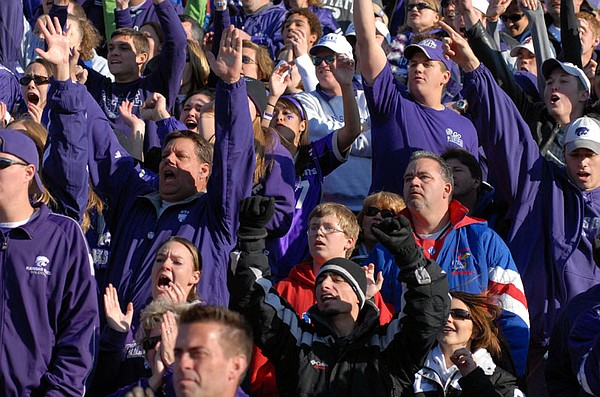 Jeffery Clark and his father Jeff Clark were surrounded by cheering Kansas State fans Saturday afternoon. Kansas beat Kansas State 39-20 saturday at Memorial Stadium.