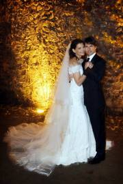 In this photo released by Rogers and Cowan, actor Tom Cruise and actress Katie Holmes pose in their wedding attire on Saturday at the 15th-century Odescalchi Castle overlooking Lake Bracciano outside of Rome.