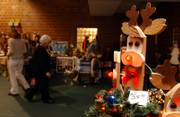 A group of glowing red-nosed Rudolphs light the way to the 30th annual Holiday Bazaar on Sunday at the Lawrence Community Building, 115 W. 11th St. The event featured seasonal crafts, food and other items.