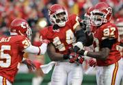 Kansas City Chiefs safety Jarrad Page (44) celebrates the game-clinching interception with teammates cornerback Lenny Walls (35) and linebacker Keyaron Fox (97). Page's pick helped the Chiefs hold off the Raiders, 17-13, Sunday in Kansas City, Mo.